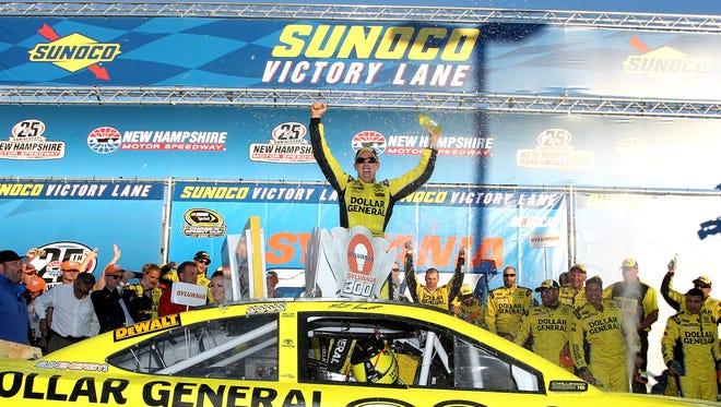 Matt Kenseth celebrates after winning the Sylvania 300 Sunday at New Hampshire Motor Speedway.