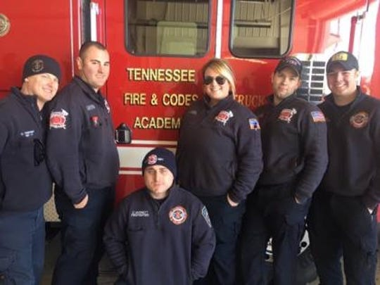 Brittney Barry, La Vergne's first female full-time firefighter, poses with her co-workers during her time as a volunteer.