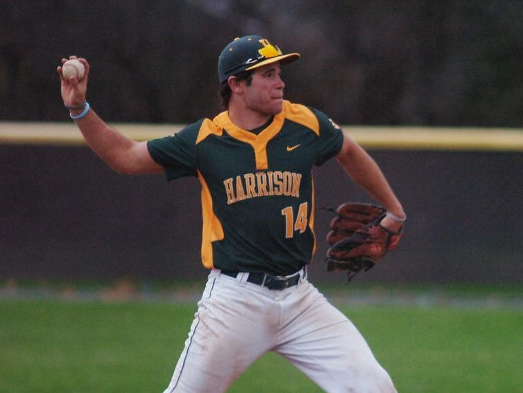 Junior shortstop Jared Char fires the ball to first base for a Harrison putout.
