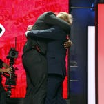 Mississippi State's Chris Jones greets NFL Commissioner Roger Goodell after being selected by the Kansas City Chiefs.