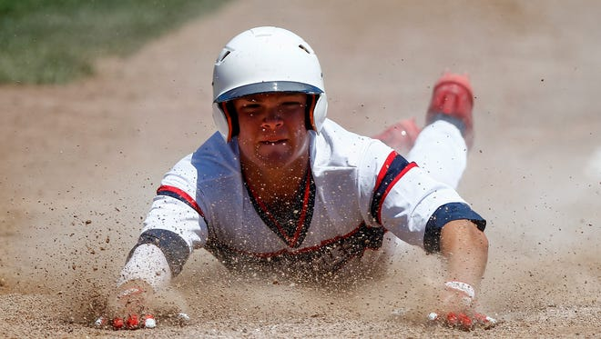Southern California baserunner Kyler Arenado slides into home for a run against the Nashville Knights during Game 6 of the Connie Mack World Series on Wednesday at Ricketts Park.