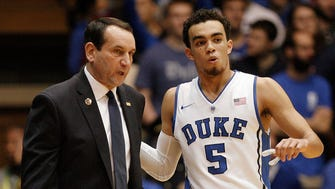 Mike Krzyzewski talks with guard Tyus Jones during a November game against Army.