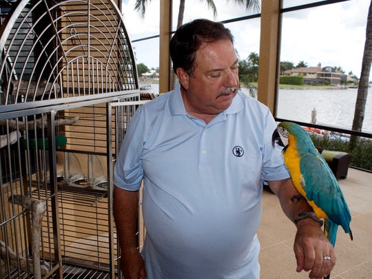 Jim and his parrot Billie at home on Marco Island.