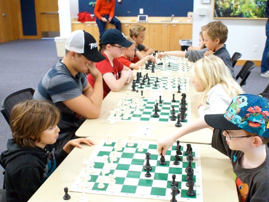 Students competing in the four rounds of chess.