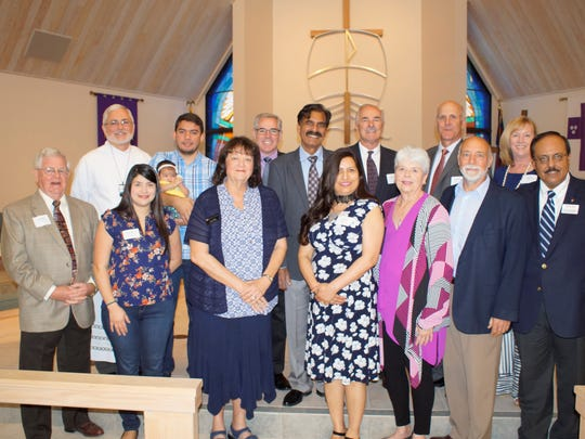 From left, Dennis Hess, MLC Foundation; Rev. Vann Ellison, St. Matthew's House; Maria, baby Lucia and Jorge Garces, Pelican Lutheran Church; Kathy Miller, Lifeline Family Center; Randolph Fauser, Grace Place Wellness Ministries; Jay and Julie Dass, Voice of Faith; Joe Sustersic, MLC Foundation; Lou Weber, Stars of Bethlehem; Kent White, CALMS; Mike Weber, Stars of Bethlehem; Leesa Carls, MLC Foundation; Rev. Farrukh Kahn, Poblo International Ministries.