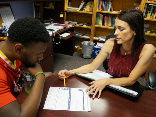 "Celneque ""C.J."" Bobbitt, a junior student who transferred to New Mexico State University this year to play on the men's basketball team, goes over his nutrition and body fat percentage with Raquel Garzon, nutrition and wellness Extension specialist in the College of Agriculture, Consumer and Environmental Sciences' Family and Consumer Sciences department. Bobbitt is one of several NMSU athletes who are working with Garzon on their nutrition and resiliency to help increase their athletic performance."
