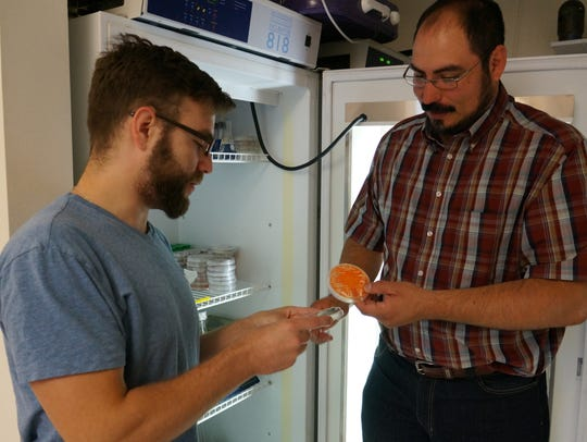 Omar Holguin, right, an assistant professor in the