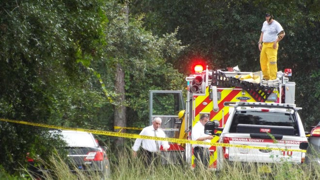Volusia County sheriff's investigators said a body was found in a burning car near DeLand on Tuesday.