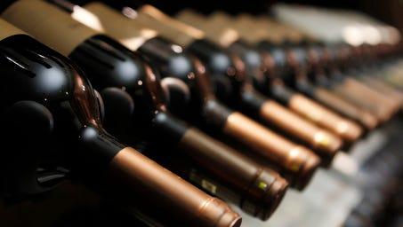 Bottles of wine in row.
