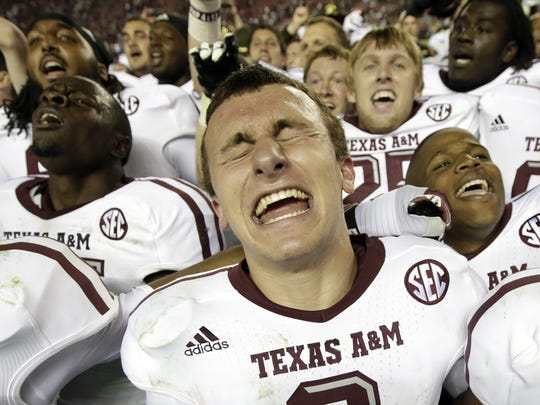 Johnny Manziel celebrates Texas A&M's upset win over eventual 2012 national champion Alabama at Bryant-Denny Stadium in Tuscaloosa.