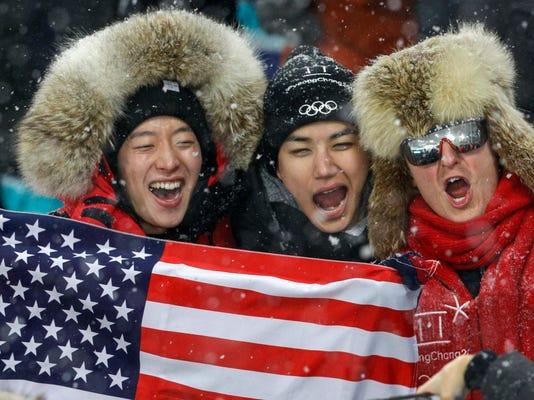 USA fans cheer during the women's 4x6-kilometer biathlon relay at the 2018 Winter Olympics in Pyeongchang, South Korea, Thursday, Feb. 22, 2018. (AP Photo/Gregorio Borgia)