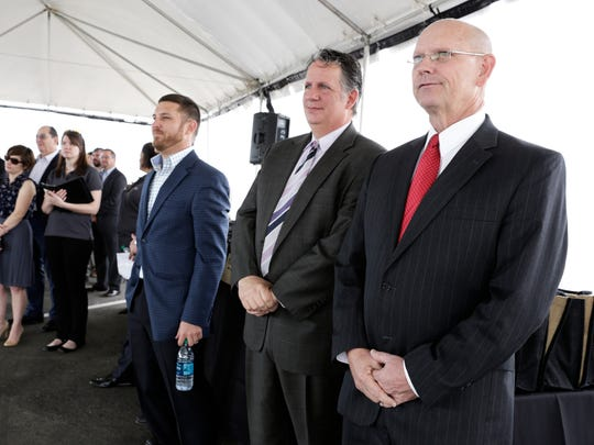 Parish Mayor-President Joel Robideaux, left, stands near his predecessor, Joey Durel, during a grand opening ceremony for the Ambassador Town Center in Lafayette March 23, 2016.