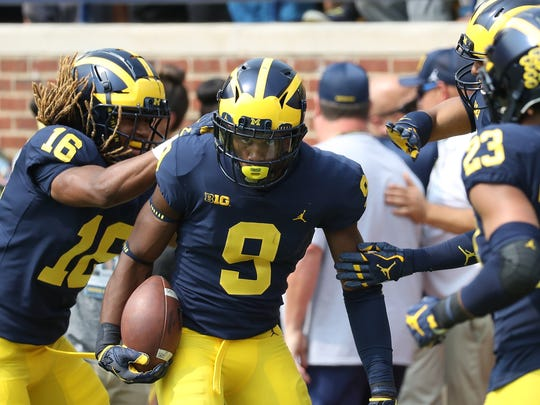 Michigan's Donovan Peoples-Jones (9) celebrates after running a 79-yard punt return back for a touchdown in the third quarter against Air Force at Michigan Stadium on Sept. 16, 2017.