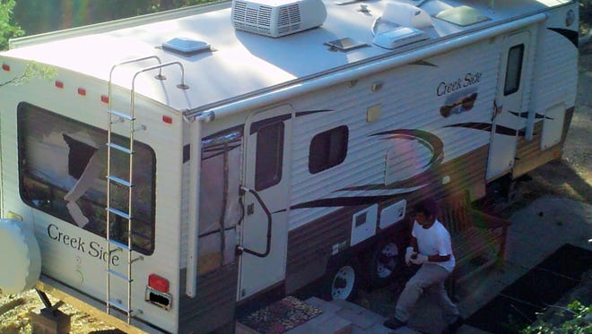 A surveillance image of a burglar who broke into a camper in Prescott while its owners were away in mid-April.