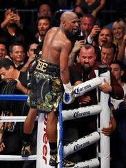 Floyd Mayweather Jr. celebrates after defeating Conor