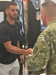 Titans quarterback Marcus Mariota shakes hands with