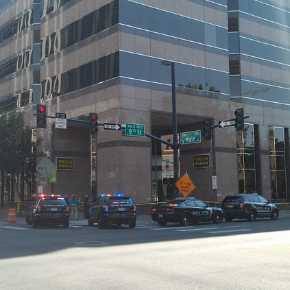 Numerous police cars surrounded the Wells Fargo building in downtown Boise this afternoon.