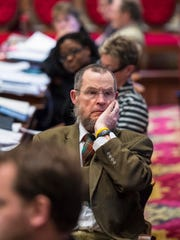 Rep. Jim McCullough, D-Williston, listens as Rep. Paul Poirier, I-Barre City (not pictured), offers an amendment to raise revenues by raising the income tax rate for wealthier Vermonters as the House considers the tax bill at the Statehouse in Montpelier on Thursday.