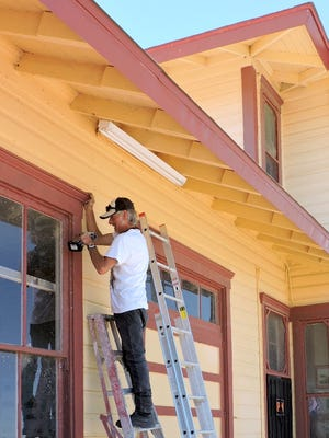 """The historic railroad train depot in Columbus, NM is undergoing a face lift. Windows are being repaired, shingles nailed down and a fresh coat of paint is being applied. The depot dates back to the 1916 raid on the town by Mexican rebel Francisco """"Pancho"""" Villa and his revolutionaries. The depot is home to the Columbus HistoricalSociety Museum which houses many artifacts and literature detailing the raid that took place on March 9, 1916 where half the town was burned to the ground and 18 Americans lost their lives."""