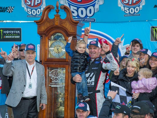 Clint Bowyer, center right, celebrates after winning a NASCAR Cup Series auto race at Martinsville Speedway in Martinsville, Va., Monday, March 26, 2018. (AP Photo/Matt Bell)