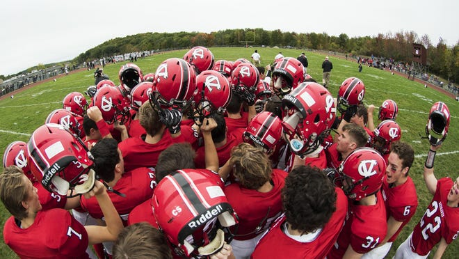CVU huddles together before the start of the high school football game between the St. Johnsbury Hilltoppers and the Champlain Valley Union Redhawks at CVU high school on Saturday afternoon October 1, 2016 in Hinesburg. (BRIAN JERKINS/for the FREE PRESS)
