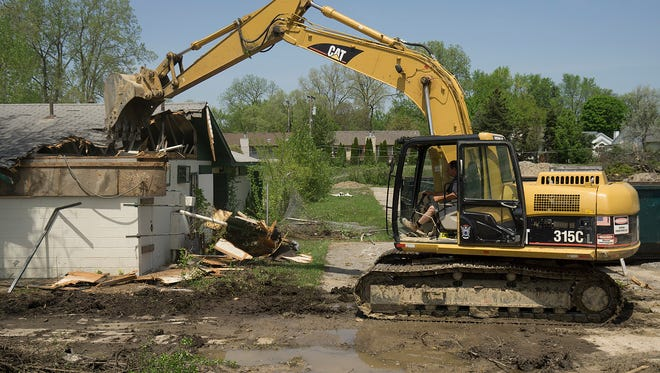 Demolition begins on the CB Swim Club site.