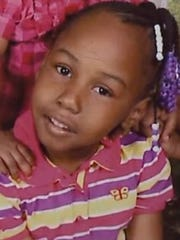 Sinai Miller, 9, was shot in the leg while selling