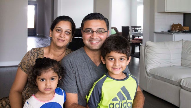 Houston residents Yatin Thaker and his Dipal Thaker with their children Agastya, 6, and Aashvi, 2, who survived and moved out from their home in Richmond neighborhood on Tuesday, Aug. 29, 2017.