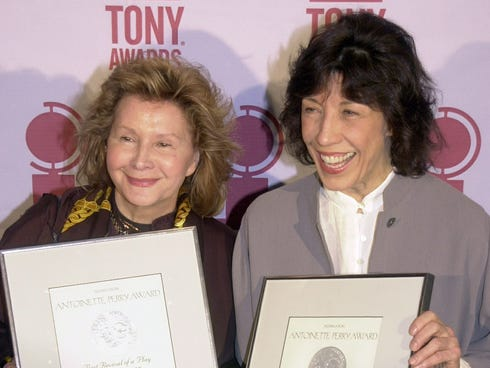 Lily Tomlin, right, and Jane Wagner hold up the Tony Award nominations they earned as producers of
