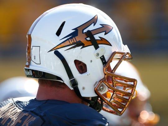 """Arizona State's """"Desert Fuel"""" helmet on Saturday, Nov. 8, 2014 at Sun Devil Stadium in Tempe,."""