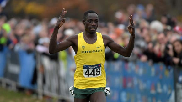 Nov 21, 2015; Louisville, KY, USA; Edward Cheserek of Oregon wins in 28:45 during the 2015 NCAA cross country championships at Tom Sawyer Park. Mandatory Credit: Kirby Lee-USA TODAY Sports