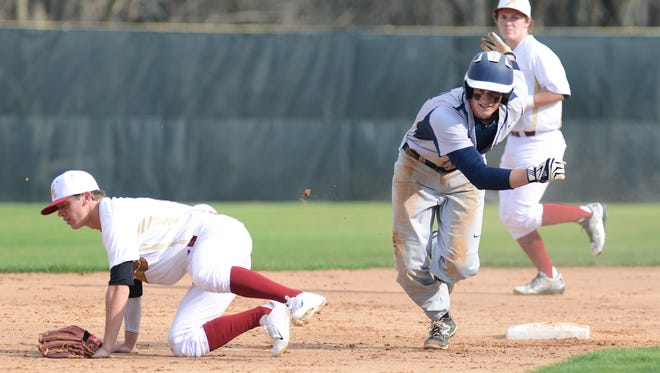 Garrett Blaylock, right, and Roberson are the Mountain Athletic Conference 4-A champions in baseball.