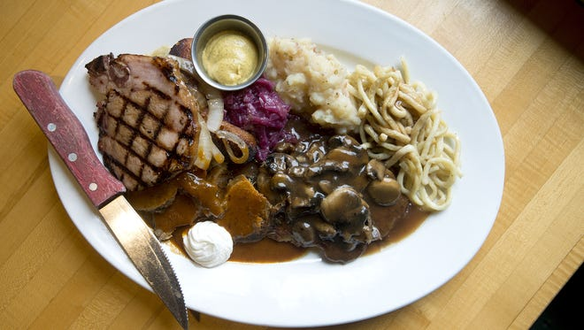 The pork German  Sampler at Black Forest Restaurant in Arden has knackwurst, bratwurst, saurbraten, kassler rippchen and schnitzel Jaeger style and comes with sides of sauerkraut, red cabbage, German potato salad and spaetzle. The pork German Sampler at Black Forest Restaurant in Arden is knackwurst, bratwurst, saurbraten, kassler rippchen and schnitzel Jaeger style and comes with sides of sauerkraut, red cabbage, German potato salad and spaetzle. Photographed Thursday, Sept. 24, 2015.