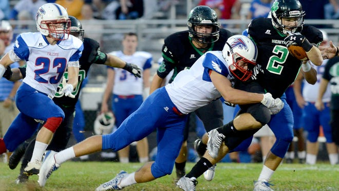 West Henderson's Tristan Thomas makes a tackle during a 2015 game at Mountain Heritage.