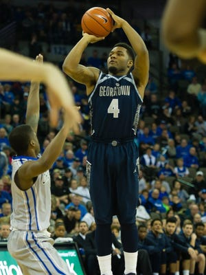 Georgetown Hoyas guard D'Vauntes Smith-Rivera (4) attempts a shot against the Creighton Bluejays.