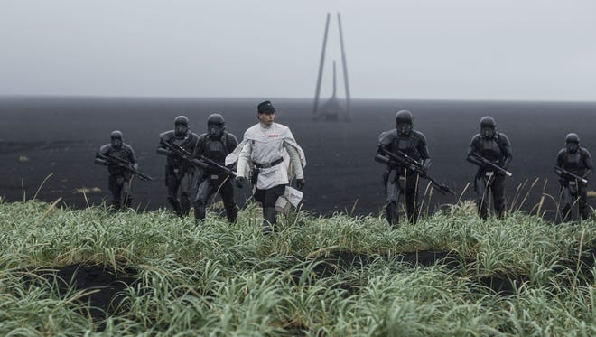 Orson Krennic (center, Ben Mendelsohn) takes his Death Troopers on a mission in 'Rogue One: A Star Wars Story.'