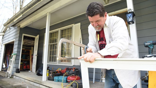 Volunteer Bill Otis, a contractor by trade, prepares to install a new storm door on Diane Meier's home in Hopewell Junction during the Rebuilding Together Dutchess County's National Rebuilding Day on Saturday.