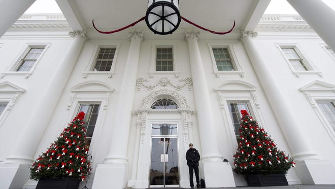 """Christmas trees and holiday decorations in the theme of """"The Gift of the Holidays"""" are seen at the North Portico of the White House on Nov. 29, 2016."""