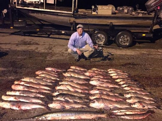 Trenton's Brent Smith is pictured with the 48 Asian silver carp, buffalo, spotted gar and long nose gar he killed while bow fishing last Friday in Mississippi.