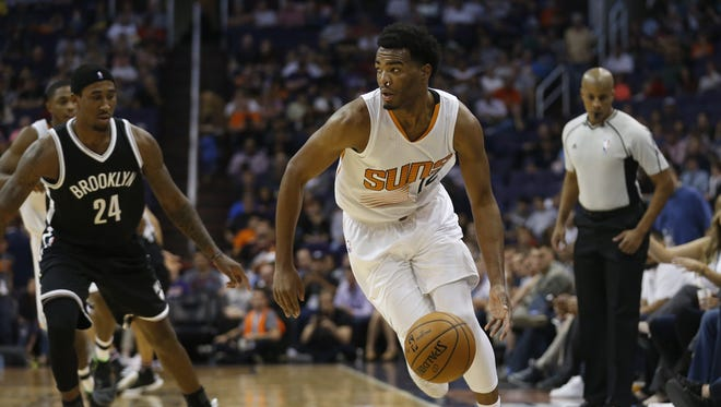 Suns' TJ Warren (12) picks up a loose ball and heads to the hoop against Nets' Rondae Hollis-Jefferson (24) in the second half at Talking Stick Resort Arena on November 12, 2016 in Phoenix, Ariz.