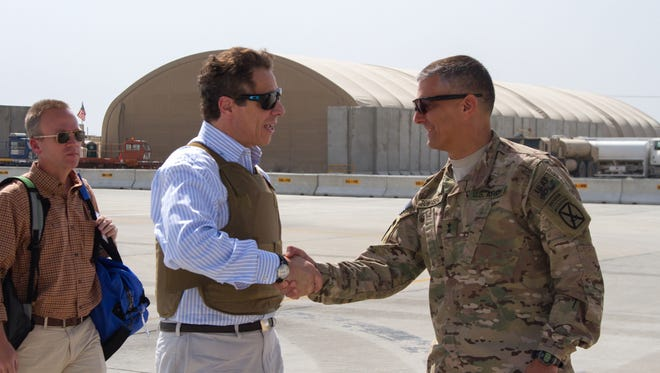 New York Gov. Andrew Cuomo is greeted by Regional Command-East Commander Maj. Gen. Stephen Townsend, right, at Bagram Airfield, Afghanistan on Sunday. Four U.S. governors made a surprise visit to Afghanistan on Saturday as part of a delegation to receive counterterrorism briefings and greet troops stationed there. Cuomo, along with Gov. Brian Sandoval of Nevada, Gov. Bill Haslam of Tennessee and Gov. Jay Nixon of Missouri, traveled with officials from the U.S. Department of Defense, which sponsored the trip, Cuomo's office said.