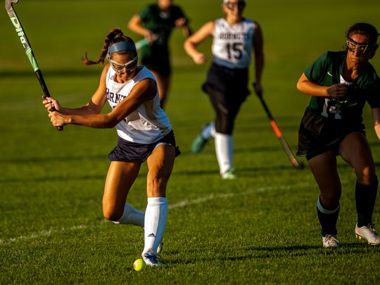 Essex senior Jenna Puleo winds up for a shot  during a high school field hockey game in September. Puleo and the Hornets enter the playoffs as the No. 2 seed.