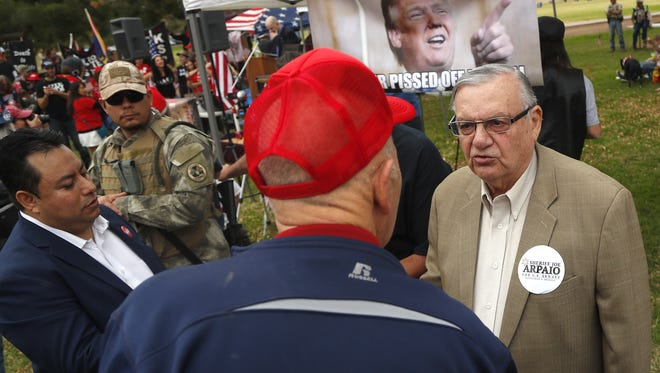 Former Sheriff Joe Arpaio talks with potential voters during a Trump Rally at Cactus Park in Phoenix on March 10, 2018.