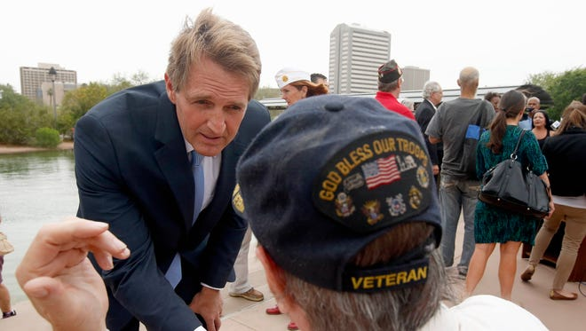 Sen. Jeff Flake, R-Ariz., speaks with Vietnam veteran Chuck Tharp, right, after an April 18 news conference where Flake and Sen. John McCain, R-Ariz., discussed recent reports that dozens of VA hospital patients in Arizona may have died while awaiting medical care in the Phoenix VA Health Care System.  The disclosures by current and former Department of Veterans Affairs employees have prompted  investigations by the House Committee on Veterans Affairs and the VA's Inspector General.