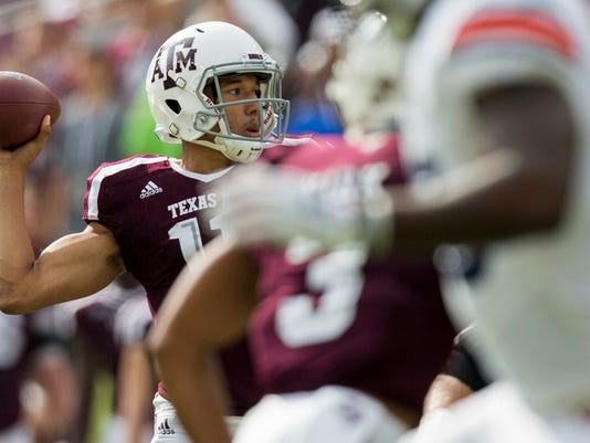 Texas A&M quarterback Kellen Mond (11) passes down field against Auburn during the first half of an NCAA college football game on Saturday, Nov. 4, 2017, in College Station, Texas. (AP Photo/Sam Craft)