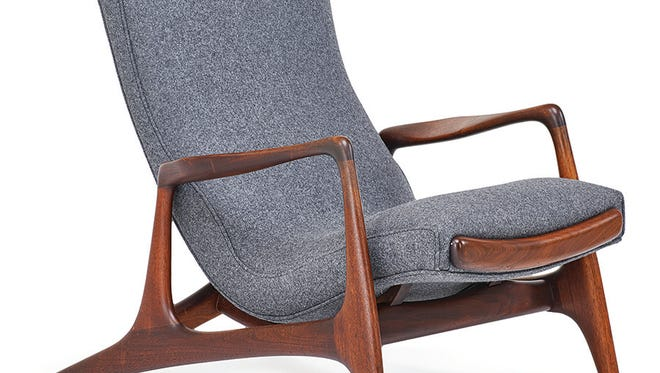 A chair with a retractable foot rest was made in the 1950s by Vladimir Kagan. It was in good condition and had the manufacturer's marks. Price: $6,875.