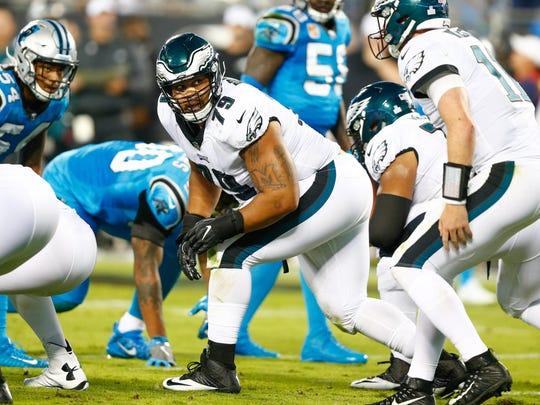 Eagles guard Brandon Brooks looks back to quarterback Carson Wentz in a 2017 game.