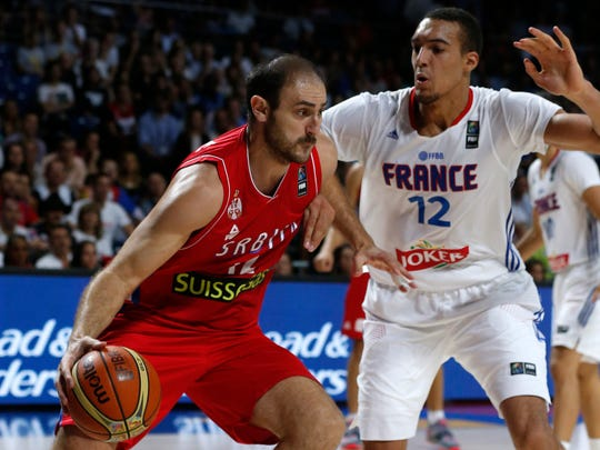 Serbia's Nenad Krstic drives the ball against France's Rudy Gobert during a basketball World Cup semifinal match between France and Serbia at the Palacio de los Deportes stadium in Madrid, Spain, Friday, Sept. 12, 2014. (AP Photo/Daniel Ochoa de Olza)