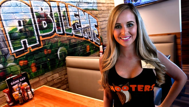 Heather Kuykendall is a trainer at the Abilene Hooters which opened Tuesday. The restaurant is located on Overland Trail, the north service road of Interstate 20.