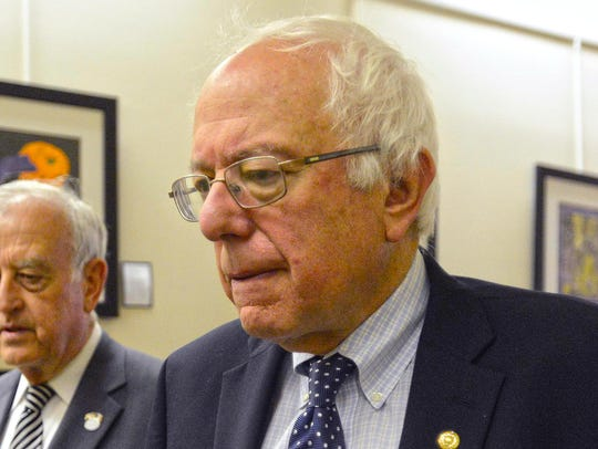 Bernie Sanders and Davenport Mayor Bill Gluba walk